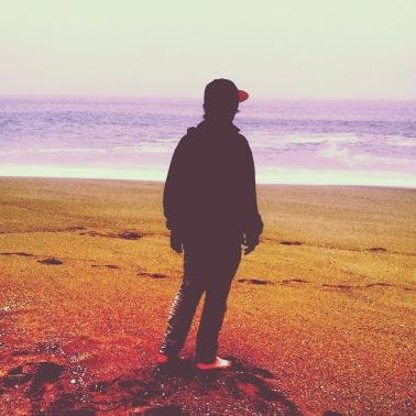 young boy , sea , sand